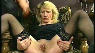 Horny slave with tiny tits is hit on her pussy and clit by her german master