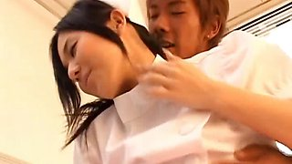 Asian nurse shows off cute