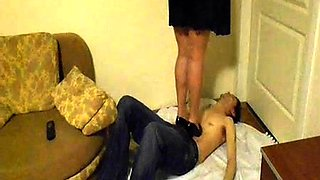 Slender amateur lady dominates a guy with her sexy feet