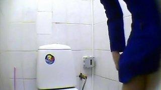 Peeping pissing women in the public toilet