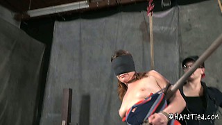 Blind folded red head is tied up and punished in the dungeon