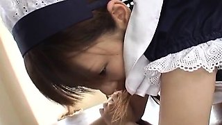 Pretty Asian maid, Natsumi exposes hot pussy for fingering