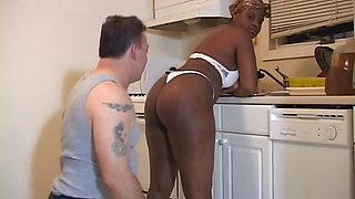 Ebony maid blackmails boss and demands him to lick her ass