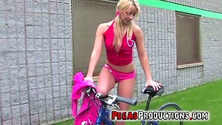 Nasty girl Candy Kiss is riding her bicycle and masturbating her pussy in public