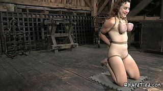 Busty chick with tied up and suspended boobs is waiting for punishment
