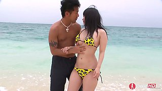 Sexy Japanese gal in bikini Hina Maeda is fucked on the beach