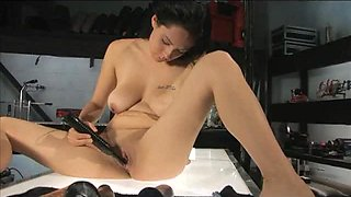 Foxy Brunette Toying Her Cunt and Getting Fucked by a Machine