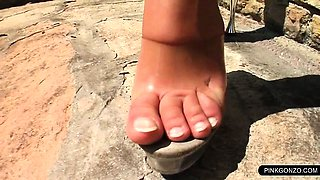 Exhibitionist sex doll loves fingering herself outdoor
