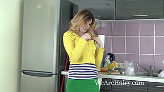 In her kitchen, Terry strips and shows off sexy body