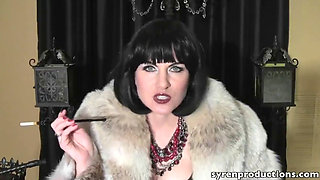 Beautiful slut smoking in a fur coat