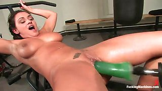 horny brunette works up a sweat while fucking machines