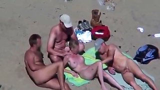Beautiful bitch groped by his husband and strangers at beach