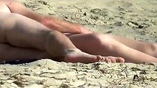Playing with his wife on the beach gets him a blowjob