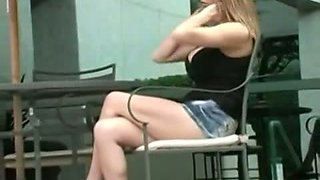 Girl with huge tits going to a café in this upskirt video