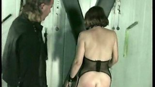 Horny slave gets her pussy spread with metal clamps and spanked on her ass in a dungeon bdsm