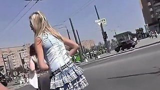 Innocent looking blonde on the bus stop