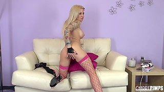 Smoldering hot blonde in fishnets plays with her big tits on cam