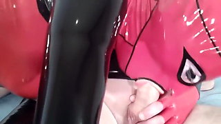 Latex Rubber Crossdresser Sucks Cock
