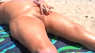 Granny touching herself on the beach