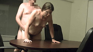 She gets bent over the conference room table