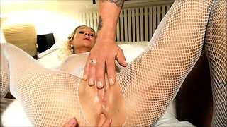 Stacked blonde cougar in fishnets gets her holes fingered