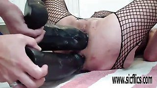 Double dildo fucking both her stretchy holes