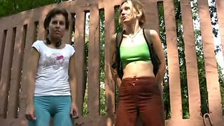 Two Russian amateur chicks piss together in public