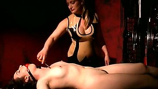 Super Hot Blonde Dominatrix Disciplines Submissive Lesbian In Latex Lingerie