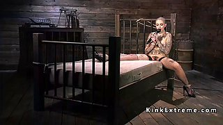 tattooed babe in bondage fucking machine