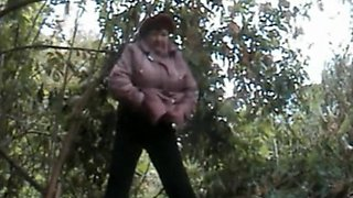 Chubby granny caught pissing outdoors