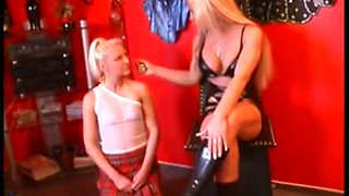 Blonde mistress dominates two submissive slaves