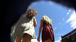 Street voyeur finds two slender amateur babes with sexy legs