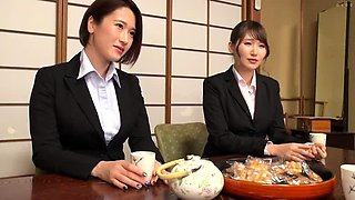 Two striking Japanese housewives teaming up on a meat pole