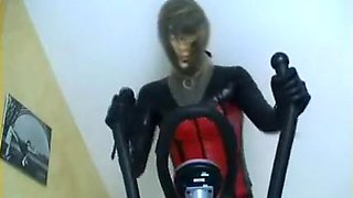 rubberdoll in rebreathing sport with rebreather hood