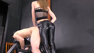 Mistress Lucy fucks the tight asshole of her slave