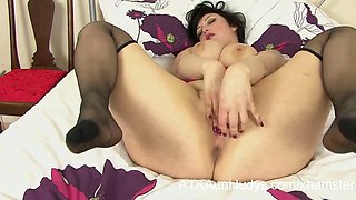 Busty Milf masturbates in her black nylon stockings