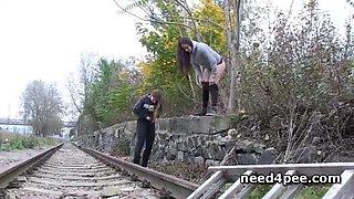 Teen girlfriends urinating on the railway