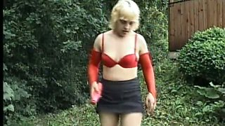 All alone rather used filth in red stuff uses a dildo to masturbate outdoors
