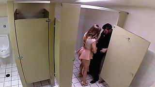 Slut in a miniskirt has a vigorous quickie in a public bathroom