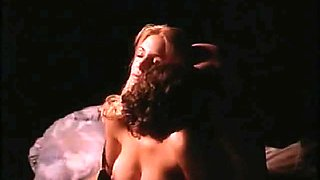 Shannon Tweed bent over a pool table as a guy has sex with