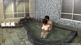 Nishizono Sakuya likes to jerk a dick with her tits in the pool