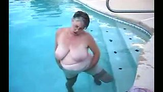 My elderly wife demonstrates her big boobs in the pool