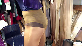 Glossy preowned pantyhose in Golden and satin negligee