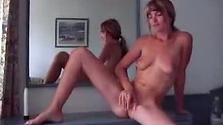 Skinny blonde fucks her shaved pussy with her sex toy