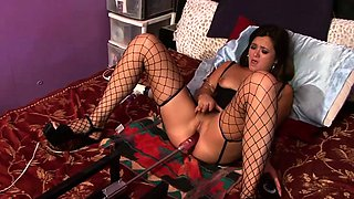 Hottie in fishnet stockings uses a machine