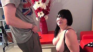 Busty Andi Blake chokes on a cock
