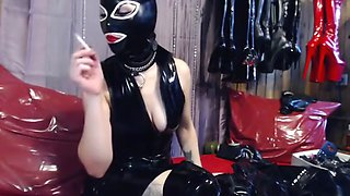 Fetish Doll with Rubber Mask Smoking