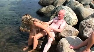 Horny old man fucking a pretty amateur girl on the beach