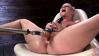 Oiled up solo blonde fetish model Lisey Sweet pounded by a machine