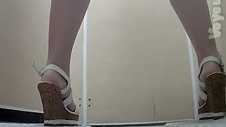 Pale skin amateur white chick filmed from behind in the toilet room